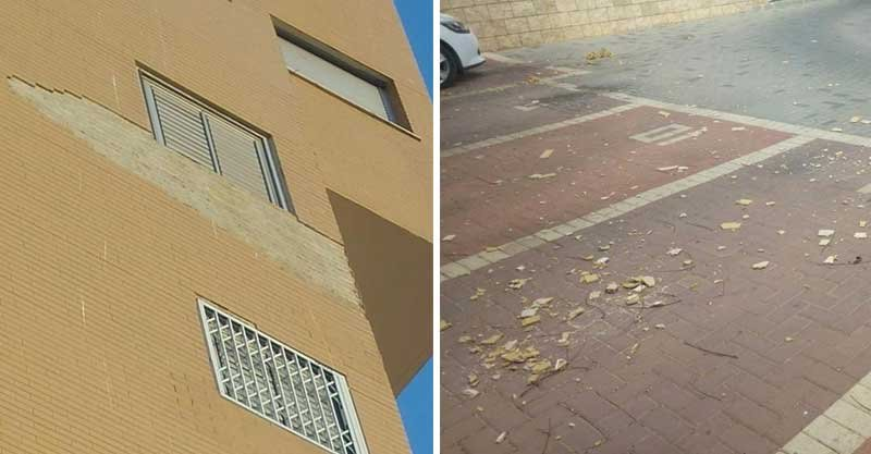 הבניין ברחוב החסידה 7 בכפר סבא, והאריחים שנשרו בחניה. צילום: באדיבות הדיירים