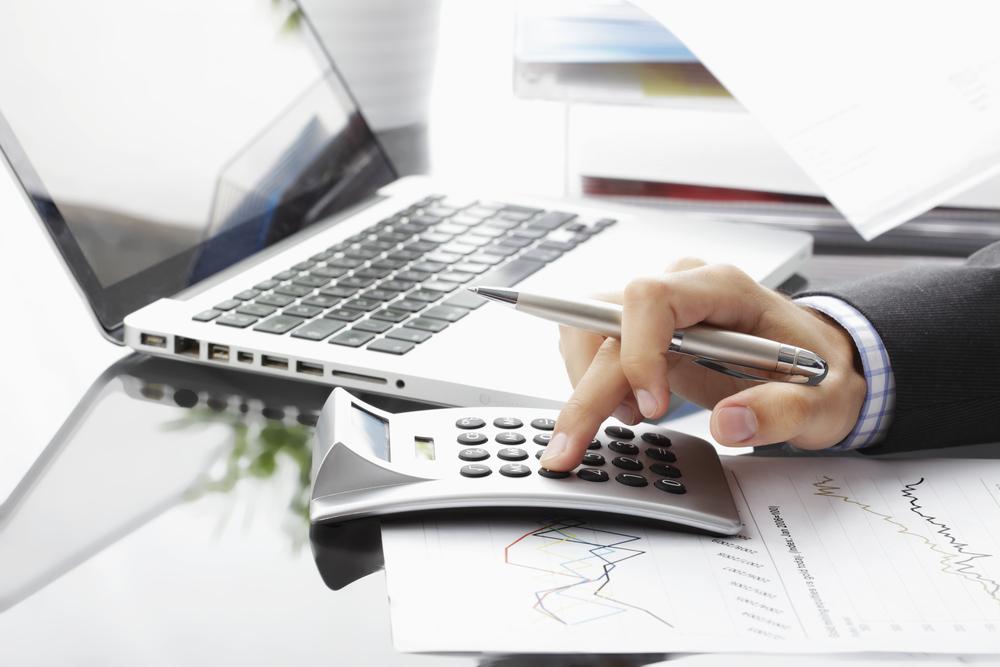 יועץ כלכלי לעסקים ומשפחות. תמונה ממאגר Shutterstock. צילום: By Kinga